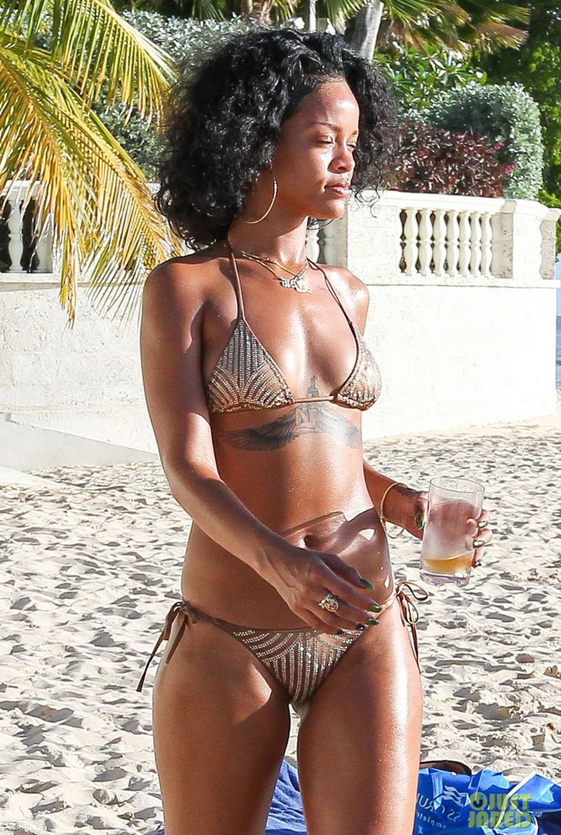 Sweet ebony babe Rihanna Rimes taking shower in her thong bikini  325677